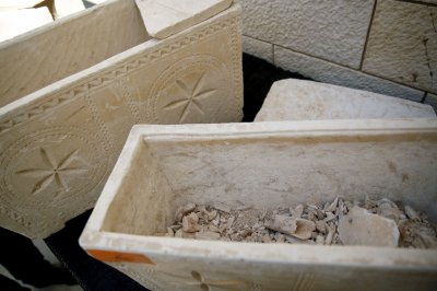 11 ancient Jewish burial boxes have been recovered in a raid on antiquities dealers in Jerusalem