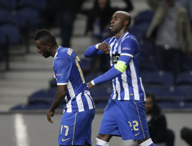 Porto's Eliaquim Mangala (R) celebrates his goal against Sevilla with teammate Silvestre Varela during their Europa League quarter-final first leg soccer match at the Dragao stadium in Porto April 3, 2014.