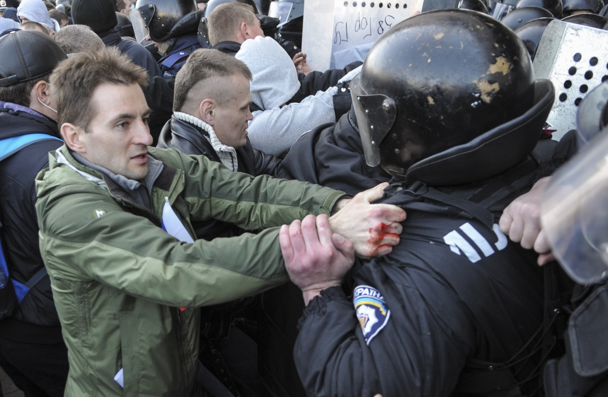 Pro-Russian activists scuffle with police near the regional government building in Donetsk
