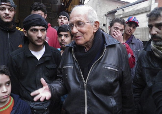 Dutch Jesuit Father Frans van der Lugt chats with civilians, urging them to be patient, in the besieged area of Homs