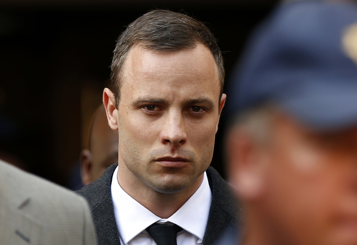 Oscar Pistorius leaves court after speaking for the first time during his trial for killing Reeva Steenkamp