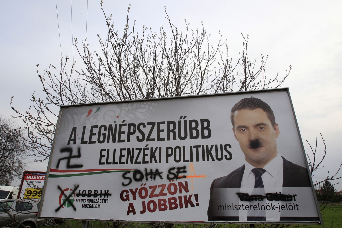 A defaced election poster of far-right Jobbik party leader Gabor Vona is seen in Budapest, April 2, 2014. Hungarians vote in a parliamentary election on Sunday that is set to return Orban into power for another four years and entrench the far-right Jobbik