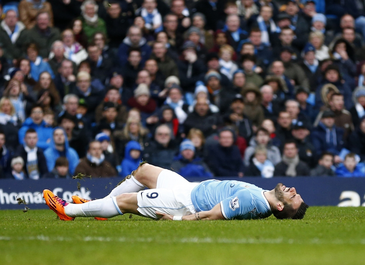 Manchester City's Alvaro Negredo lies on the ground after being awarded a penalty against Fulham during their English Premier League soccer match at the Etihad stadium in Manchester, northern England March 22, 2014.