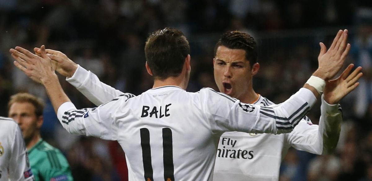 Real Madrid's Cristiano Ronaldo (R) celebrates with teammate Gareth Bale after scoring a goal against Schalke 04 during their Champions League last 16 second leg soccer match at Santiago Bernabeu stadium in Madrid March 18, 2014.