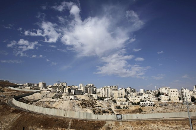 A section of the controversial Israeli barrier runs along the Shuafat refugee camp in the West Bank