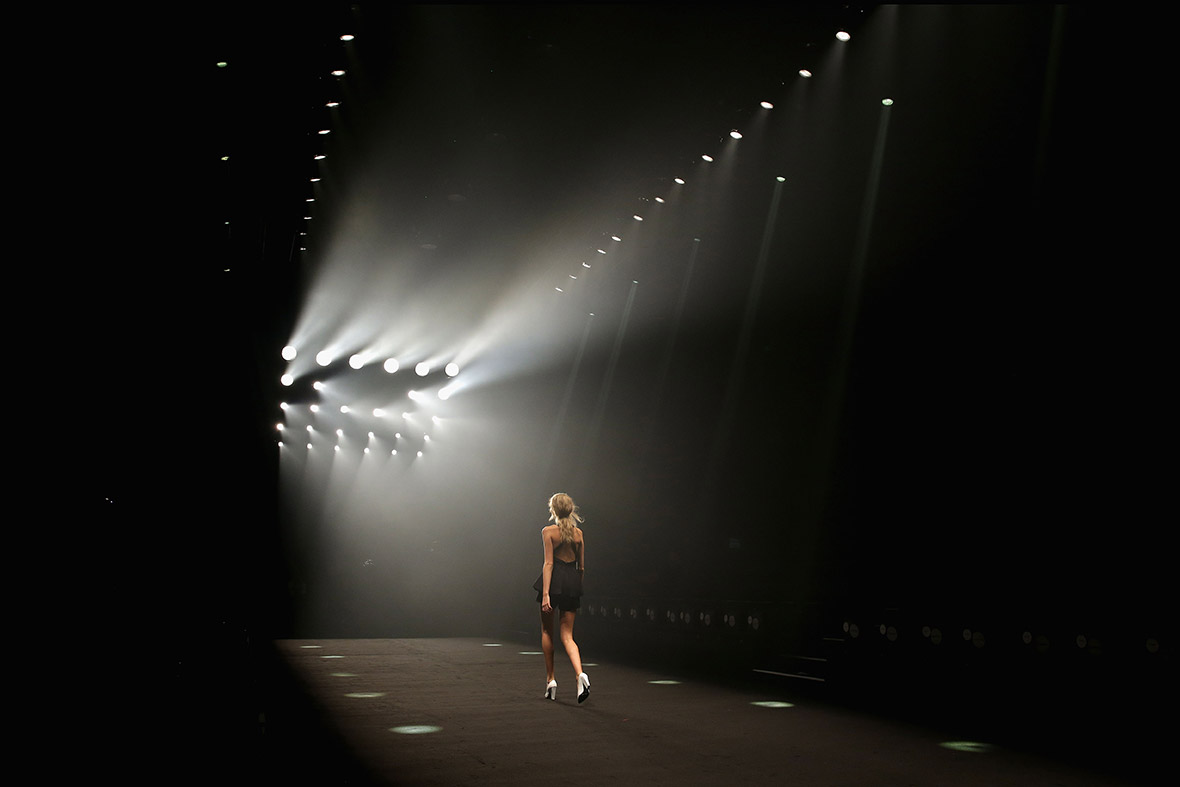 A model walks down a catwalk