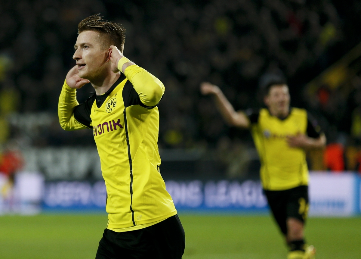 Borussia Dortmund's Marco Reus (L) celebrates after scoring a goal against Real Madrid during their Champions League quarter-final second leg soccer match in Dortmund, April 8, 2014.