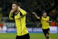 Borussia Dortmund\'s Marco Reus (L) celebrates after scoring a goal against Real Madrid during their Champions League quarter-final second leg soccer match in Dortmund, April 8, 2014.