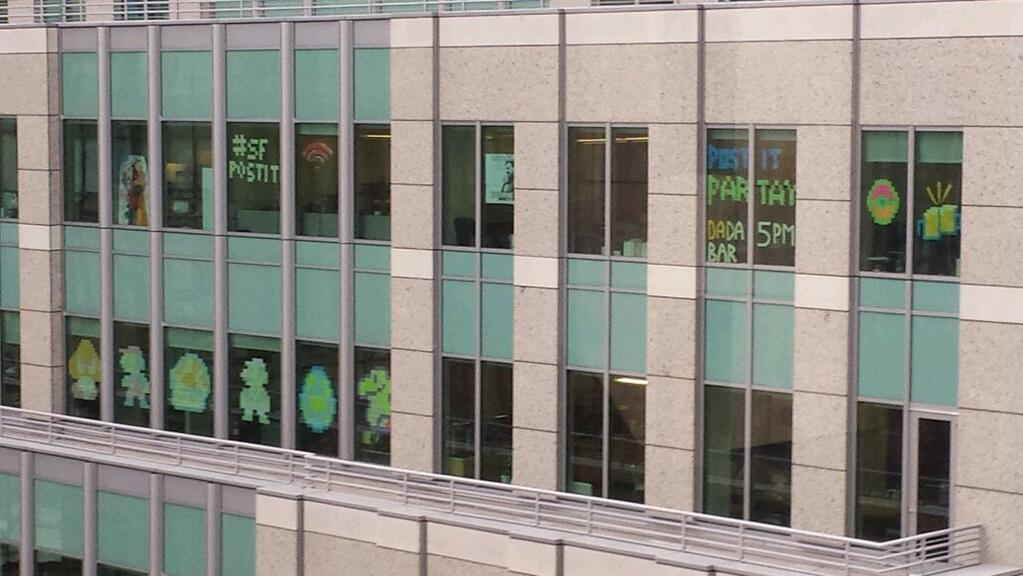 #SFpostit - a new social media trend where office workers post messages using post-it notes