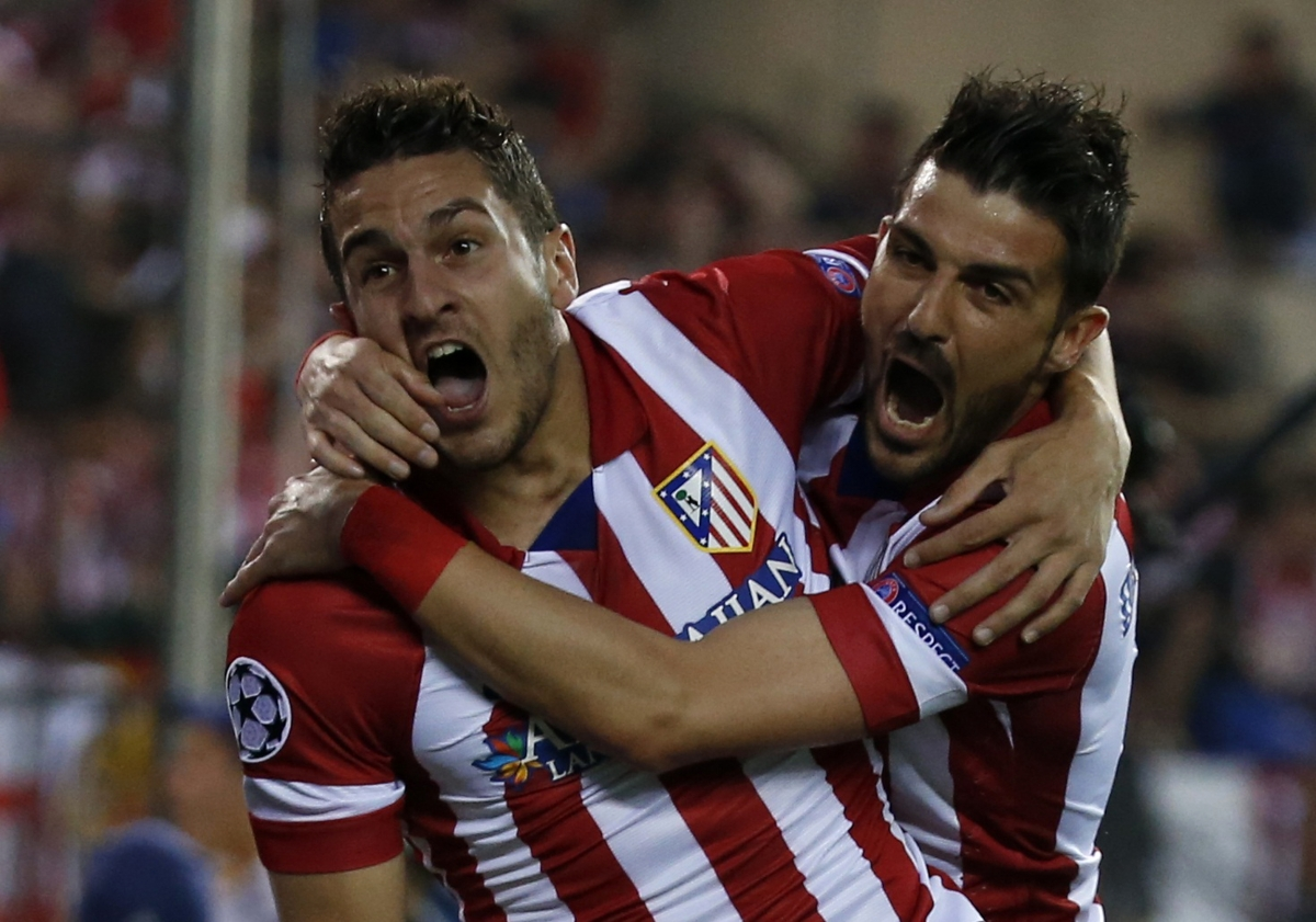 """Atletico Madrid's Jorge """"Koke"""" Resurreccion Merodio (L) and David Villa celebrate their team's first goal against Barcelona during their Champions League quarter-final second leg soccer match in Madrid, April 9, 2014."""