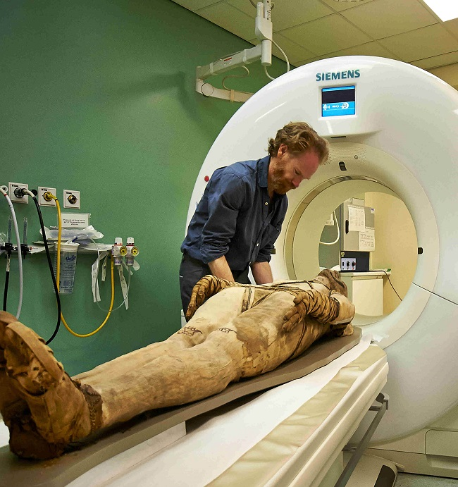 Mummy of man being scanned by cutting-edge technology