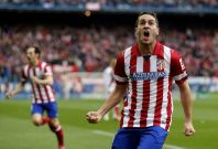 "Atletico Madrid\'s Jorge ""Koke\"" Resurrecion celebrates after scoring a goal against Real Madrid during their Spanish first division soccer match at Vicente Calderon stadium in Madrid March 2, 2014"