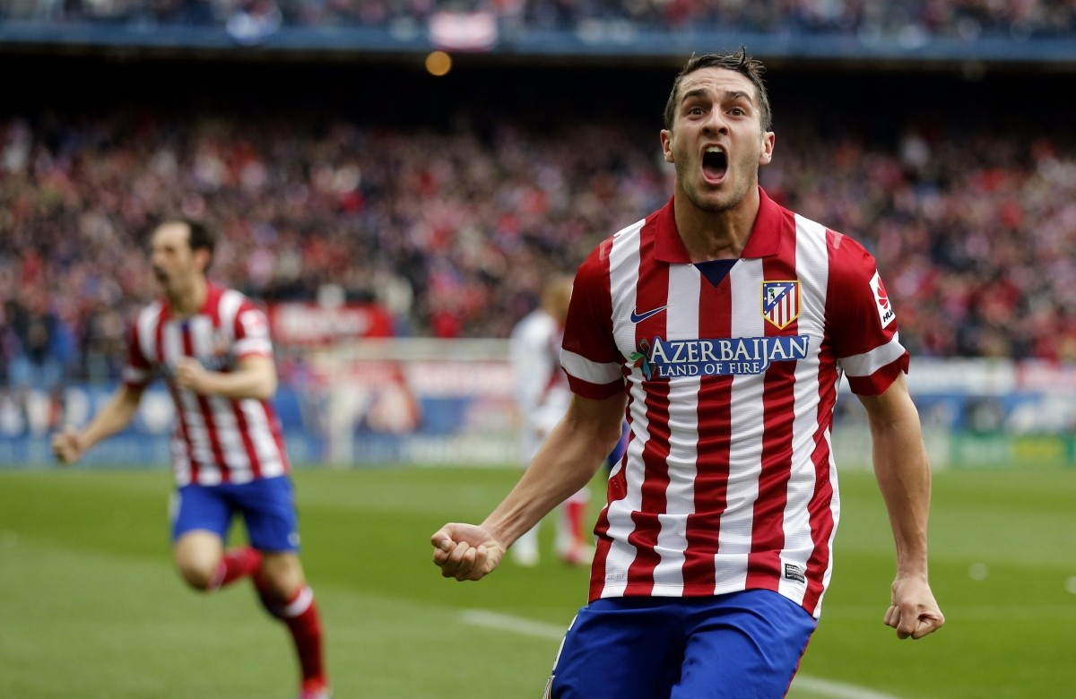 "Atletico Madrid's Jorge ""Koke"" Resurrecion celebrates after scoring a goal against Real Madrid during their Spanish first division soccer match at Vicente Calderon stadium in Madrid March 2, 2014"