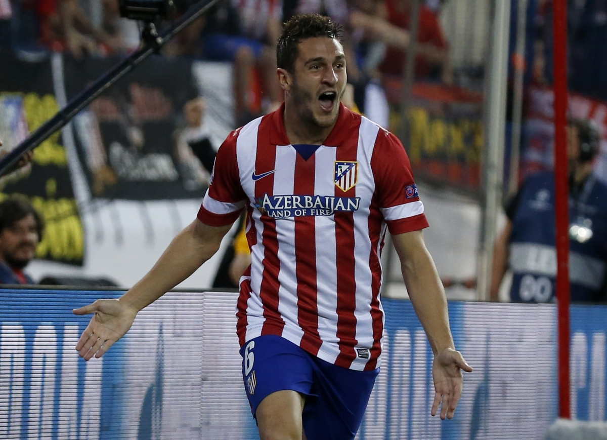 """Atletico Madrid's Jorge """"Koke"""" Resurreccion Merodio celebrates after scoring his team first gaol against Barcelona during their Champions League quarter-final second leg soccer match in Madrid, April 9, 2014."""