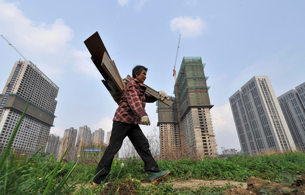 China Property Trust Sales Plunge 49% Amid Default Concerns