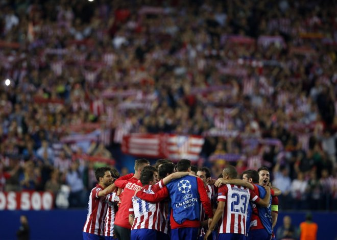Atletico Madrid players react after winning their Champions League quarter-final second leg soccer match against Barcelona, in Madrid, April 9, 2014.