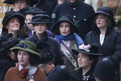 Anne-Marie Duff, Carey Mulligan, Helena Bonham Carter and Romola Garai keep warm during a break in filming