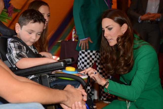 The Duchess of Cambridge chats to one of the children at the Rainbow Hospice