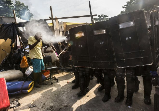 Armed police fire pepper spray in efforts at slum clearance in Brazil