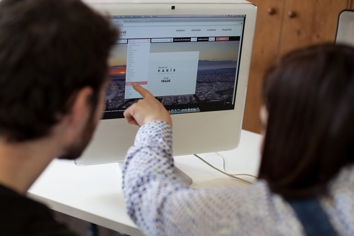 People uses the Abortion Travel's campaign website at the Abortion Travel agency store in Madrid, Spain.
