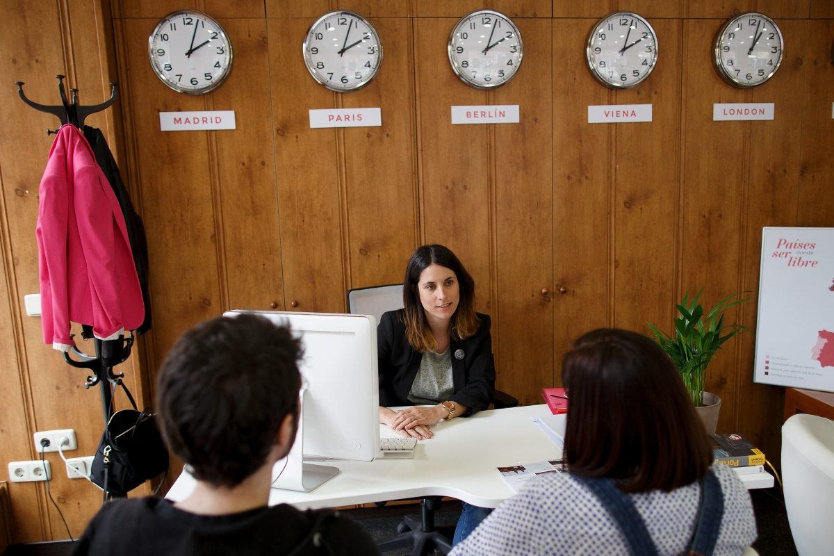 A campaigner offers information at the Abortion Travel Agency in Madrid, Spain.