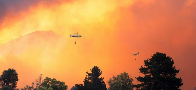 Firefighters were battling to keep control the inferno as the terrain is very steep and hilly