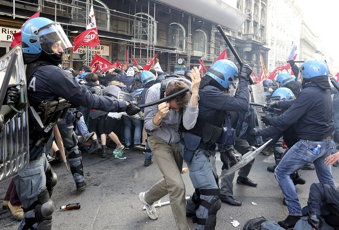 Riot police clash with anti-austerity demonstrators in central Rome.