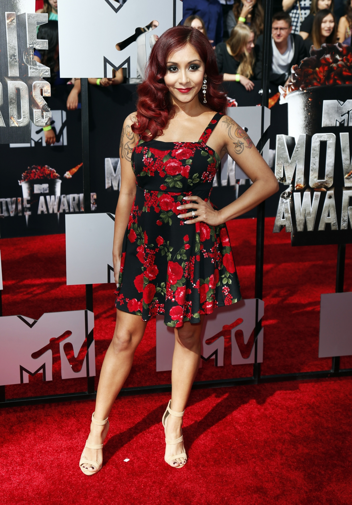 Snooki arrives at the 2014 MTV Movie Awards in Los Angeles, California.