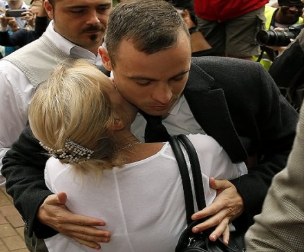 Gun killer Oscar Pistorius hugs supporter at North Gauteng High Court