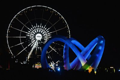 Ferris wheel and Lightweaver art installation by Alexis Rochas