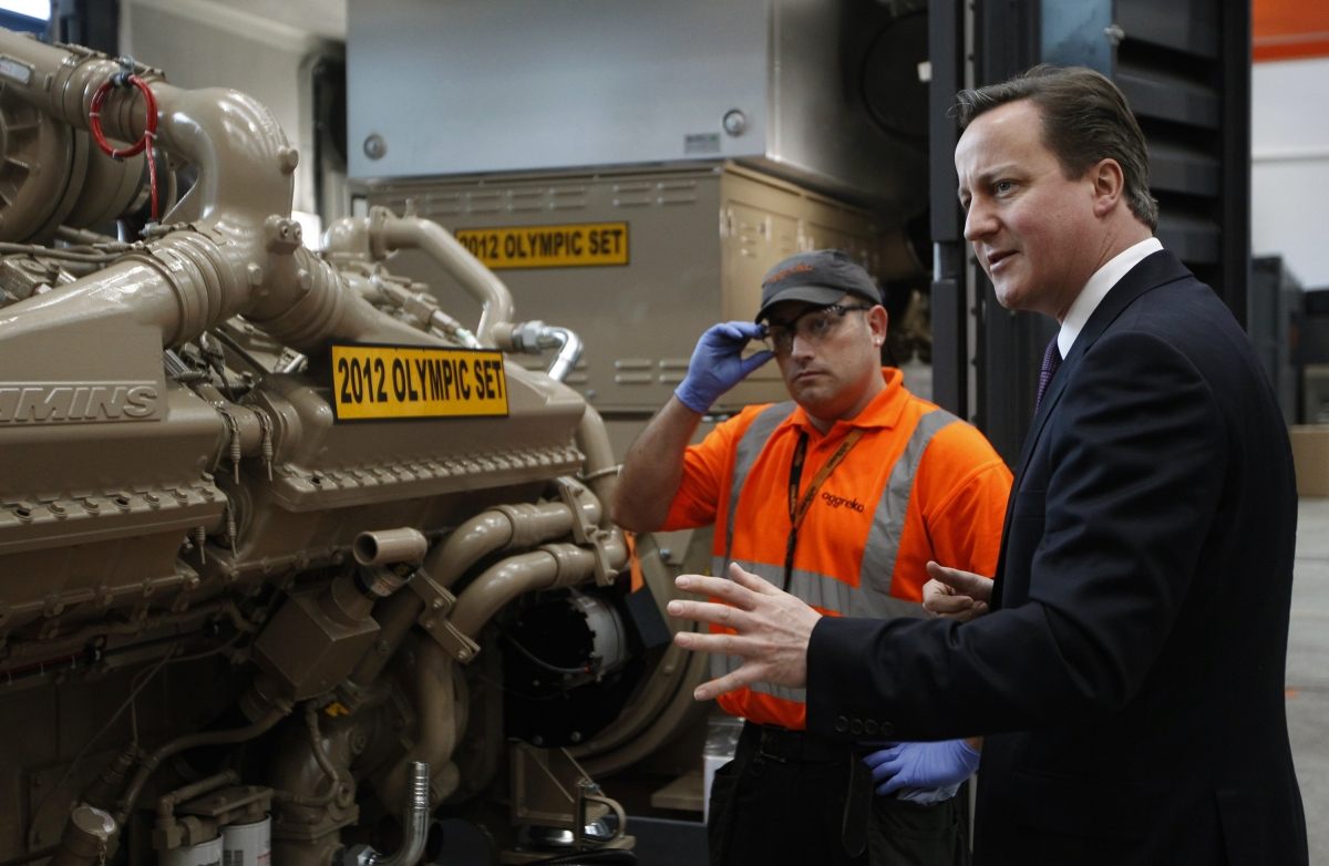 Britain's Prime Minister David Cameron speaks to workers during his visit to an Aggreko factory in Dumbarton, Scotland