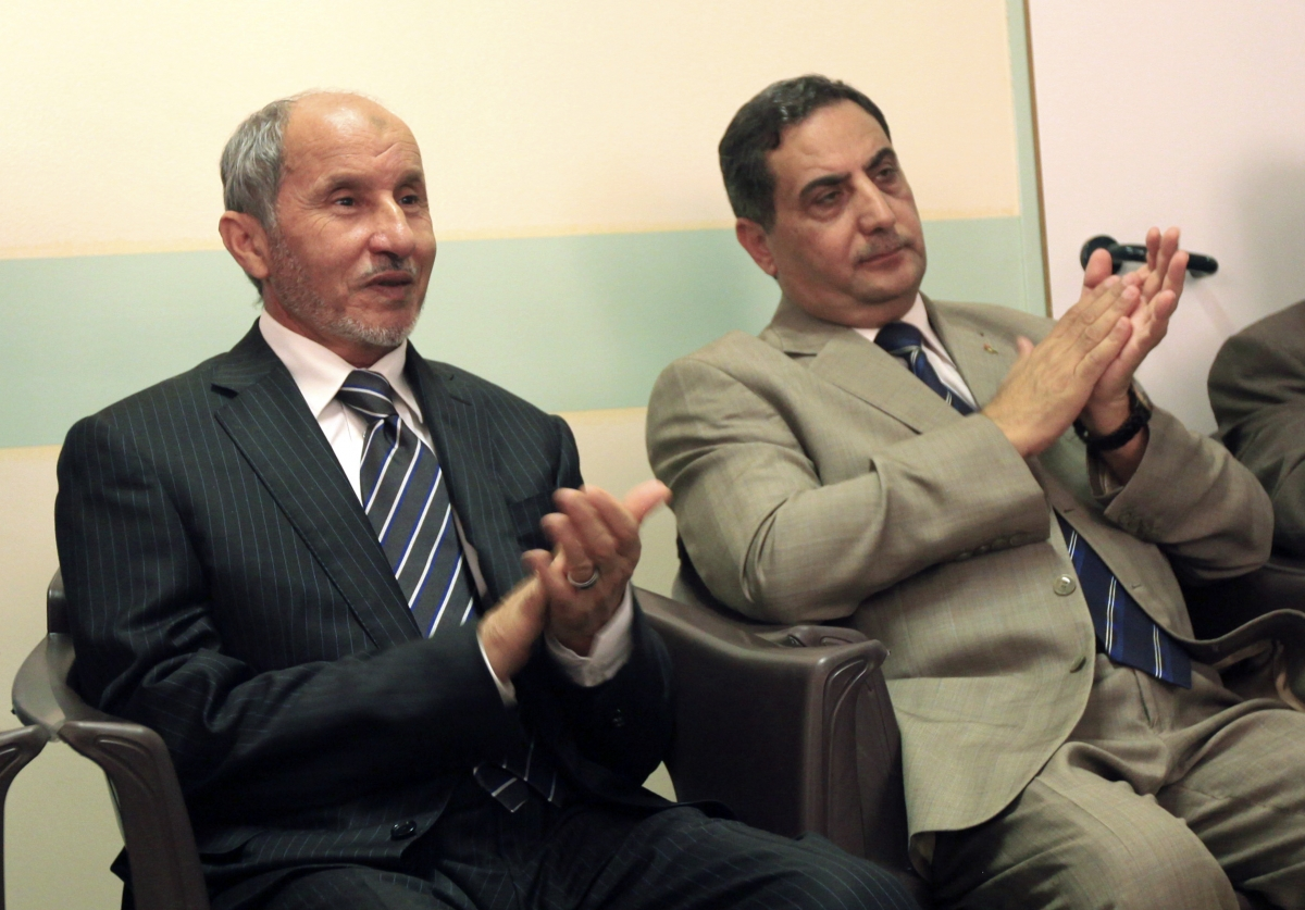 Mustafa Abdel Jalil (L), former chairman of the Libyan National Transitional Council, and Jordan's ambassador to Libya Fawaz al-Eitan