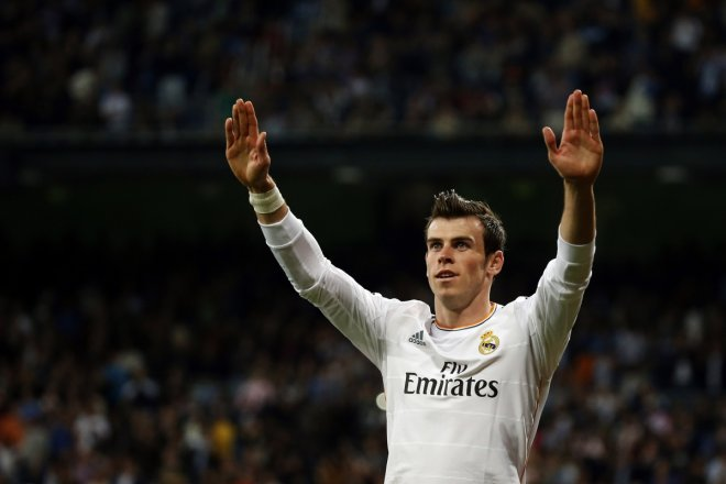 Real Madrid's Gareth Bale celebrates his goal against Almeria during their Spanish first division soccer match at Santiago Bernabeu stadium in Madrid, April 12, 2014.
