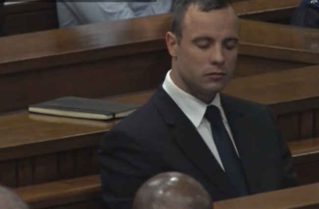 Oscar Pistorius closes his eyes after the end of gruelling cross-examination by prosecutor Gerrie Nel