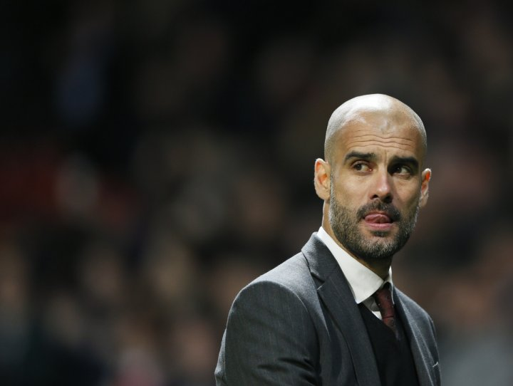 Bayern Munich's coach Pep Guardiola reacts after their Champions League quarter-final first leg soccer match against Manchester United at Old Trafford in Manchester, April 1, 2014.