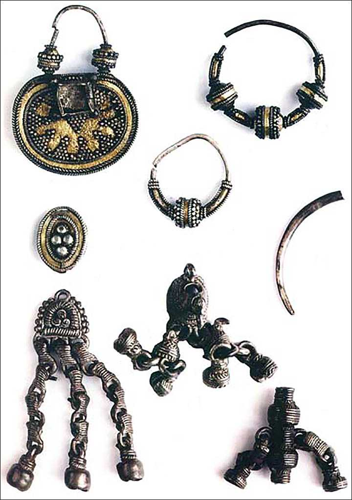 Silver medallions and jewellery found buried with the Siberian mummies