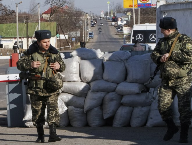 Ukrainian border guards stand at a checkpoint at the border with Moldova breakaway Transnistria region, near Odessa