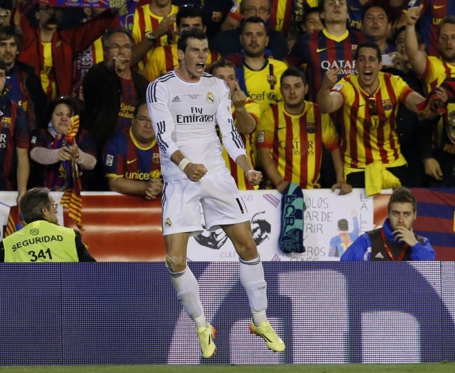 Real Madrid's Gareth Bale celebrates his goal during their King's Cup final soccer match against Barcelona's at Mestalla stadium in Valencia April 16, 2014.