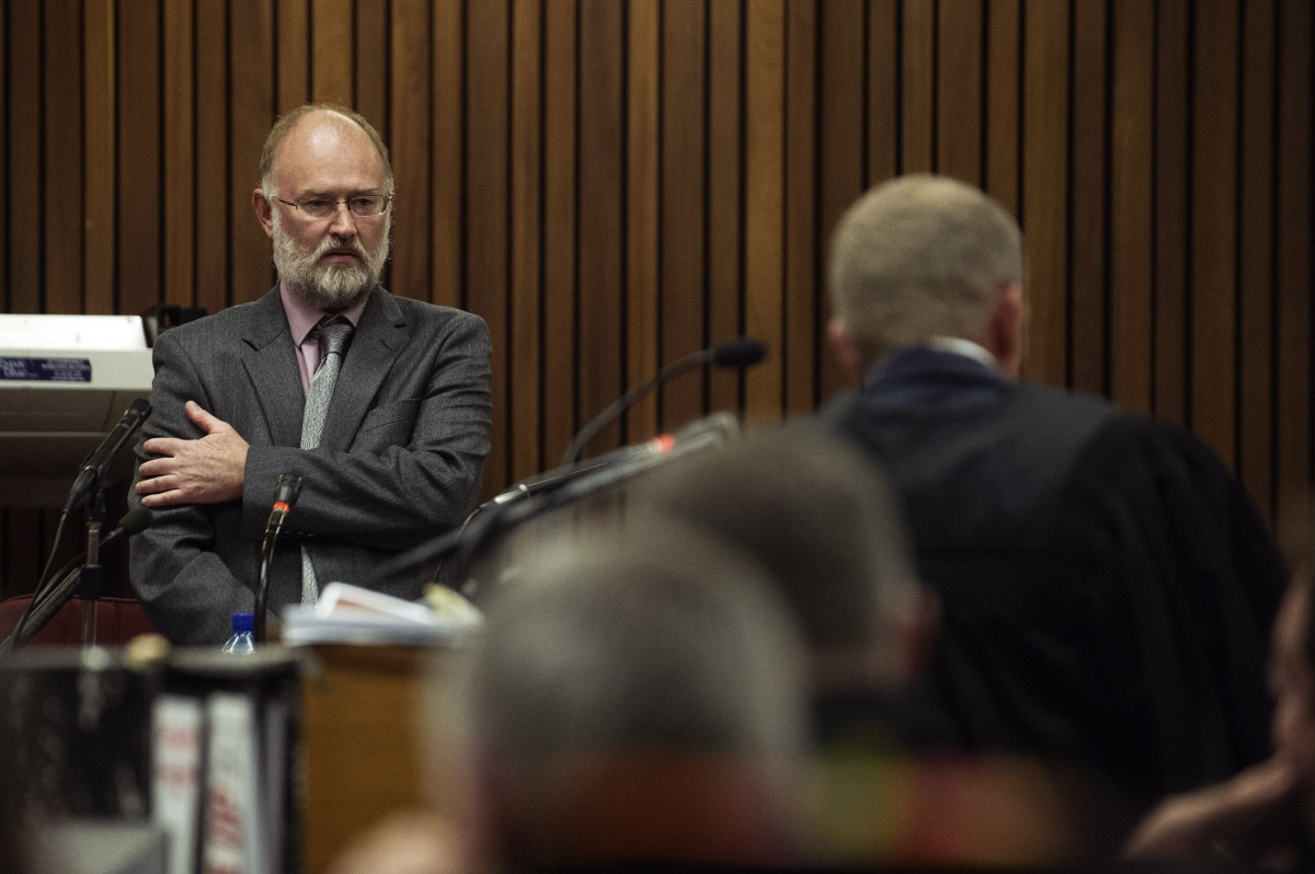 Robert Dixon (left) faces questions from Gerrie Nel during the trial of Oscar Pistorius