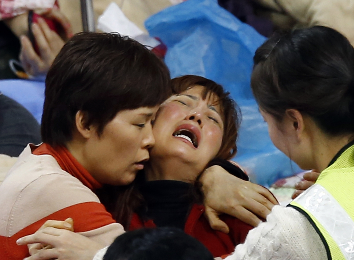 Grief overwhelms parents of missing passengers of South Korean ferry tragedy