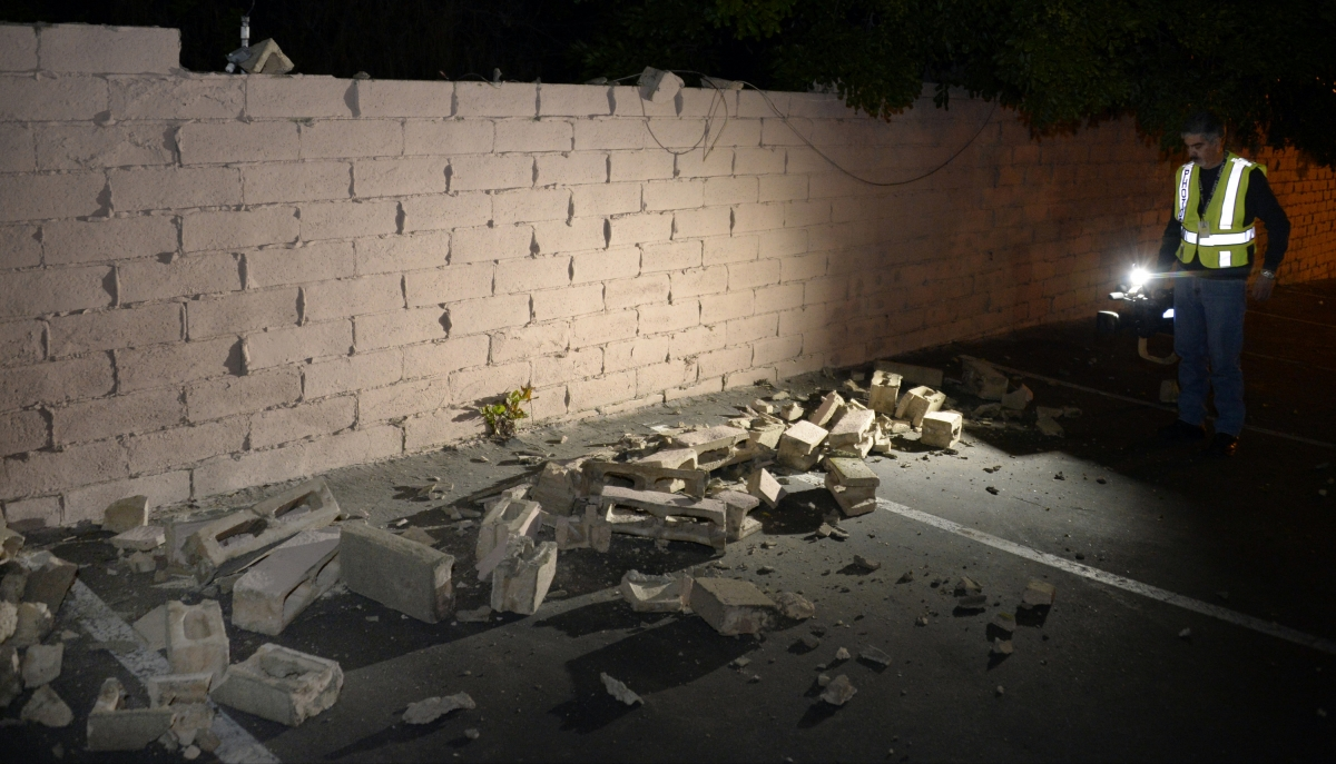 A fallen brick wall after a magnitude 5.1 earthquake in Fullerton, California March 29