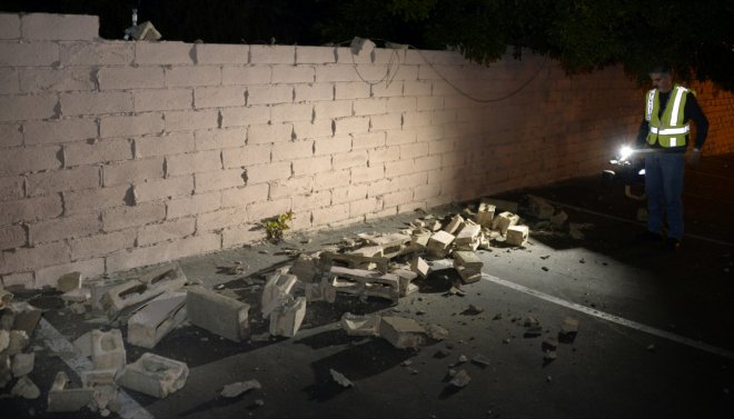 A fallen brick wall after a magnitude 5.1 earthquake in Fullerton, California March 29