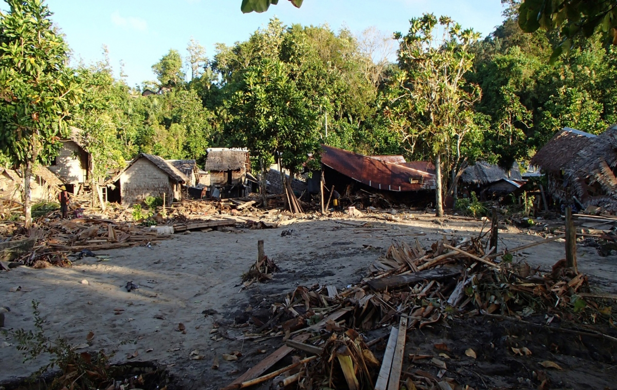 Partially destroyed houses are seen after a tsunami hit in the Venga village in Solomon Islands on February 6