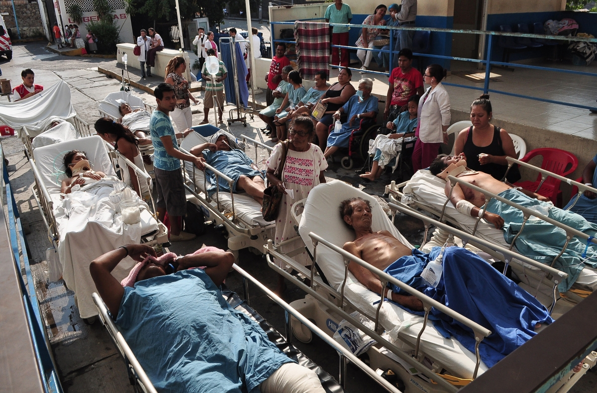 Patients are looked after by their relatives after they were evacuated from a hospital following an earthquake in Acapulco, in Guerrero state, April 18