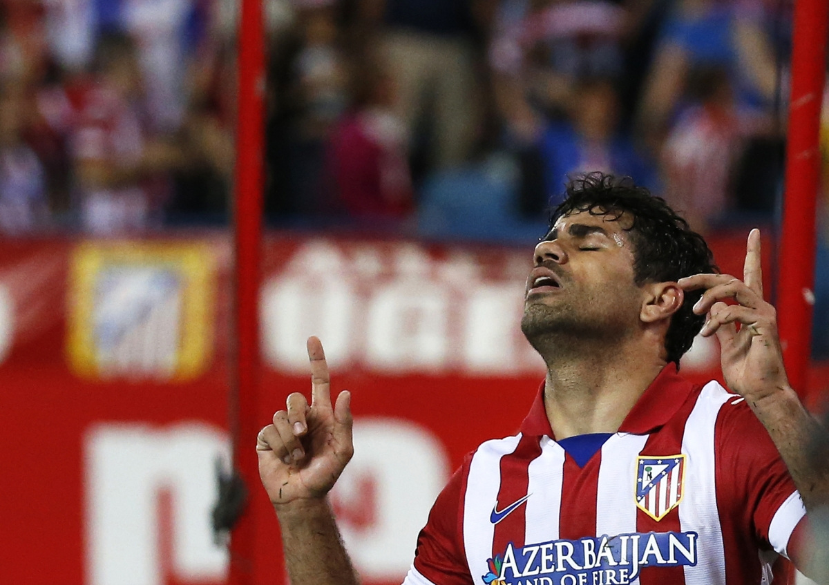 Atletico Madrid's Diego Costa celebrates his goal during their Spanish first division soccer match against Elche at Vicente Calderon stadium in Madrid April 18, 2014.