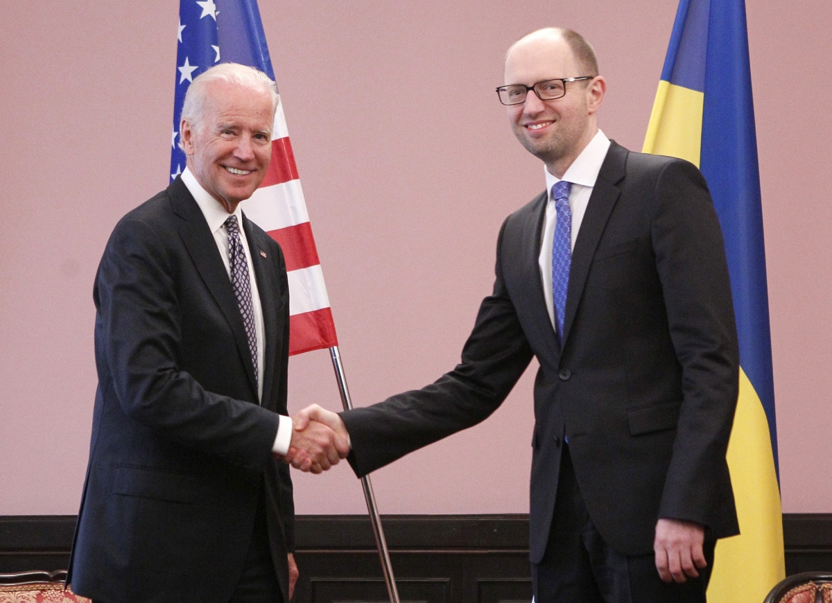 U.S. Vice President Joe Biden (L) shakes hands with Ukraine's Prime Minister Arseny Yatseniuk during a meeting in Kiev,