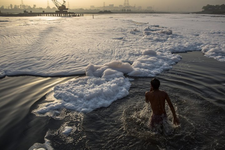 World environment day 2014 top five most polluted countries may 24 2013 a man bathes in part of the yamuna river polluted by industrial waste on the outskirts of new delhi half of the 20 most polluted cities in publicscrutiny Images