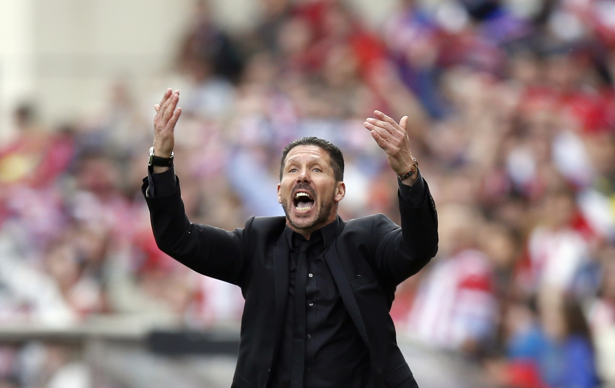 "Atletico Madrid's coach Diego ""Cholo"" Simeone reacts during their La Liga soccer match against Villarreal at Vicente Calderon stadium in Madrid April 5, 2014."