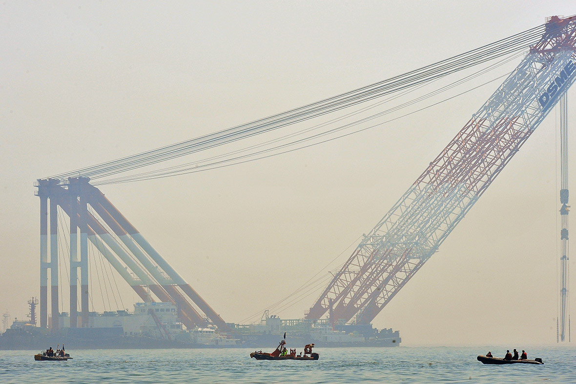 Cranes are used as part of recovery operations at the site of the sunken Sewol ferry off the coast of the South Korean island of Jindo