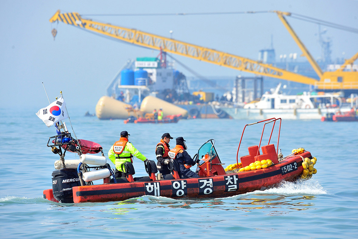 South Korean rescue teams take part in recovery operations at the site of the sunken Sewol ferry, marked with buoys